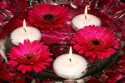candles and flowers in water