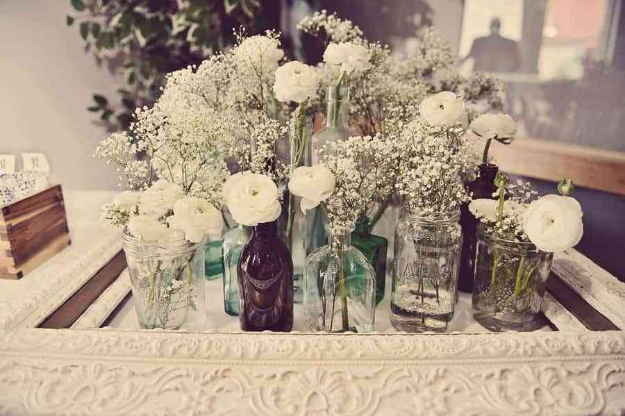 vintage-wedding-reception-flowers-white-centerpieces-mason-jars