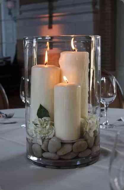 centros de mesa con velas y piedras